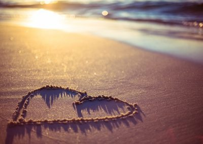 one heart drawn in the sand